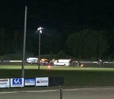 Logan Messerly/The Associated Press<br>This image provided by Logan Messerly shows ambulances on the scene at Canandaigua Motorsports Park on Saturday in Canandaigua, N.Y.