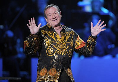 "This April 6, 2008 file photo shows actor-comedian Robin Williams speaks on stage at the ""Idol Gives Back"" fundraising special of ""American Idol"" in Los Angeles."