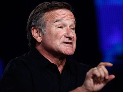 """Comedian Robin Williams speaks during the HBO panel for """"Robin Williams: Weapons of Self-Destruction"""" at the Television Critics Association summer press tour in Pasadena, Calif., on Thursday, July 30, 2009. (Associated Press)"""