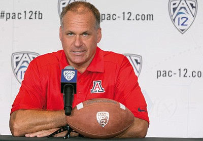 The Associated Press<br>Arizona head coach Rich Rodriguez takes questions back on July 23 at the Pac-12 media days in Los Angeles. Rodriguez is among many football minds who believe the Pac-12 has never been better.