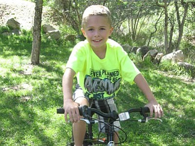 In August, Connor turns 9 and starts fourth grade at Lincoln Elementary in Prescott. Connor lives with his mother and his grandpa, and he has friends at school but not many in his neighborhood, which is pretty quiet. (Courtesy photo)