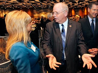 Arizona Speaker of The House Andy Tobin, right, R-Dewey, talks with Cheryl Flake, wife of Arizona Sen. Jeff Flake, at the annual Arizona Chamber of Commerce and Industry legislative luncheon, Jan. 10 in Phoenix. Tobin is running in the Republican primary for the 1st Congressional District seat now held by Democrat Ann Kirkpatrick. He faces Arizona state Rep. Adam Kwasman and rancher and businessman Gary Keine in the Aug. 26 primary. (Ross D. Franklin/The Associated Press)