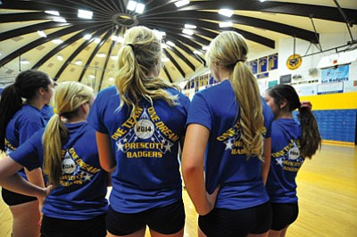 Matt Hinshaw/The Daily Courier<br>Prescott's Bailey Anderson, left, and teammate Sierra Howard take a break during practice on Thursday at PHS, wearing shirts with the team's 2014 motto.