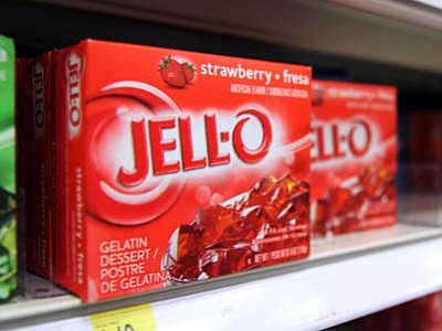 This Aug. 19, 2014, photo shows boxes of Jell-O on a shelf at a store in Vauxhall, N.J. Despite its enduring place in pop culture, sales of Jell-O have tumbled 19 percent from five years ago, with alternatives such as Greek yogurt surging in popularity. (The Associated Press/Dan Goodman)