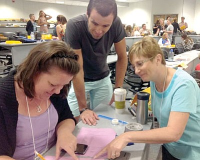 Courtesy photo<br> Teachers Leta Barnes and Mark Feeney, and Mountain View Principal Joanne Bindell participate in an activity.