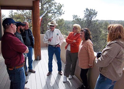 Glen Buettner, ASFD/Courtesy photo<br> Gary Roysdon, wearing his usual cowboy hat, talks to PAWUIC members about hazardous fuels mitigation during a field trip in March.