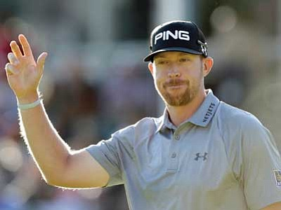 Hunter Mahan waves to the crowd when he arrives at the 18th hole Sunday at The Barclays.  (AP Photo)