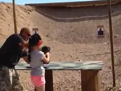Firearms instructor Charles Vacca of Lake Havasu City works with a student Monday before being accidentally shot. (Video screen shot)