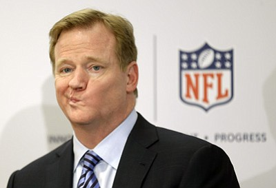 Seth Wenig/The Associated Press, file<br>In this March 11, 2013, file photo, NFL Commissioner Roger Goodell takes questions during a news conference in New York.