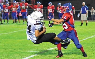 Matt Hinshaw/The Daily Courier<br>The Wildcats' Josh Jahns (15) slams Arizona Charter's Santiago Ramirez through the air after Ramirez catches a pass Friday night at Mayer High School.