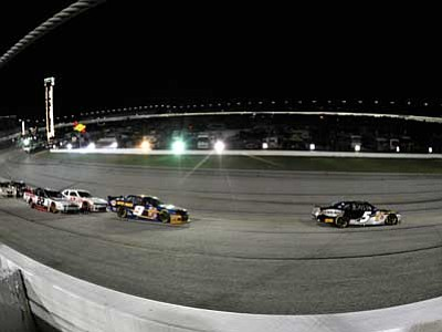 David Tulis/The AP<br> Nationwide Series driver Kasey Kahne (5) leads the pack at Atlanta Motor Speedway. Kahne won Sunday night.