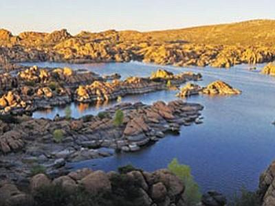 The sun sets behind Watson Lake in Prescott. (Matt Hinshaw/The Daily Courier)