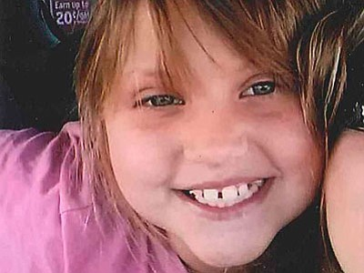 """This undated file photo provided by the Bullhead City Police Department shows Isabella """"Bella"""" Grogan-Cannella, an 8-year-old Bullhead City girl whose body was found in a shallow grave near her home Wednesday. (The Associated Press)"""