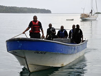 Jamaican Marine Police return to the Port Antonio Marina after a fruitless search for a plane that crashed into the ocean near Port Antonio, Jamaica, on Friday, Sept. 5. A small plane flew down the Atlantic Coast and beyond before finally crashing in the waters off Jamaica. The fate of the two or more people aboard was not immediately known. (Associated Press photo/Everard Owen)