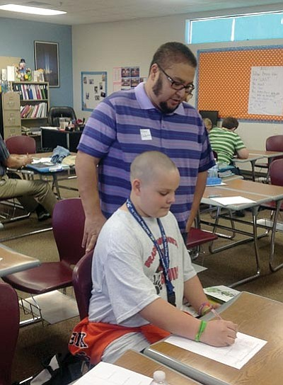 Courtesy photo/HUSD<br> Bradshaw Mountain Middle School student Aden Deherra shows his dad, Alex Deherra, a lesson on Parent Switch Day.