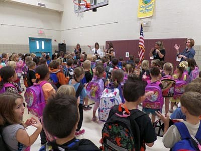 Courtesy photo<br> Students learn the Pledge of Allegiance in American Sign Language during the morning meeting.