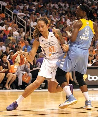 Phoenix Mercury center Brittney Griner drives inside in Game 1 of the WNBA basketball finals Sunday.  (Rick Scuteri/The Associated Press)