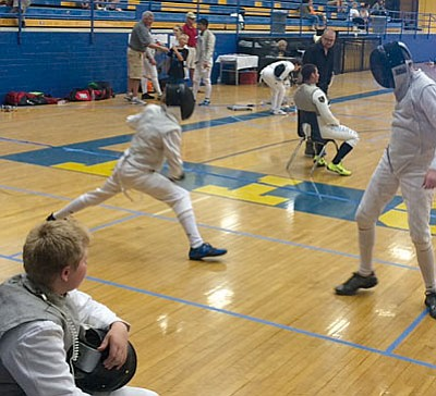 Courtesy photo<br>From left, Braeden Waples, Charlton Cornelius and Seth Rollin compete at Prescott High School at the recent fencing event.