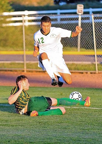 Matt Hinshaw/The Daily Courier<br>Oscar Ortiz and the Roughriders, shown hosting Scottsdale on Aug. 28 in Prescott Valley, leapt from No. 3 in the nation to No. 2 in Tuesday's latest NJCAA national poll. Yavapai is 5-0-0 and has three games in three days this week, starting Thursday.