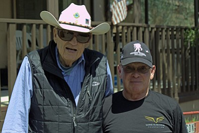 WWII Veteran Ken Henderson with Honor Flight AZ Guardian Jack Teague.