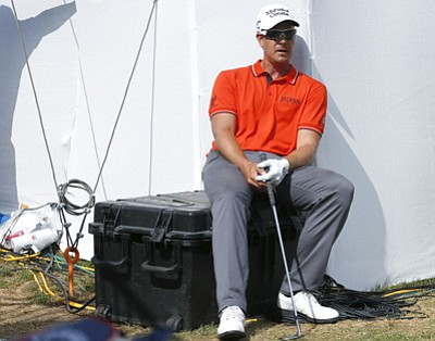 David Zalubowski/The Associated Press<br>Henrik Stenson waits for a judge to rule on a lie on the 18th hole in the third round of the BMW Championship on Sept. 6.