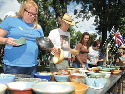 People looks for the perfect bowl to have their soup in during the 2011 Empty Bowls fundraiser on the Yavapai County Courthouse Plaza. (The Daily Courier, file photo)