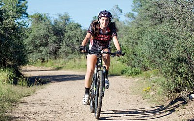 Les Stukenberg/The Daily Courier<br>Hannah Madler rips down the trail as the Bradshaw Mountain High School mountain bike team practices on the Brownlow Trail complex at Pioneer Park Thursday afternoon.