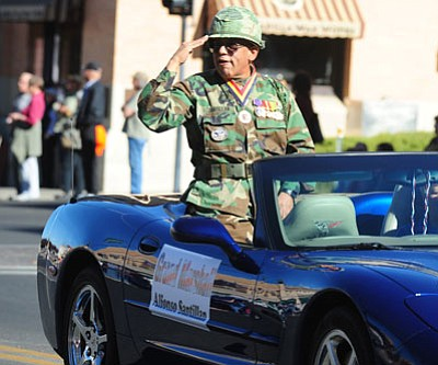 Courier file<br> Grand Marshal Alfonso Santillan salutes the crowd during the 2013 Veterans Day parade in Prescott.