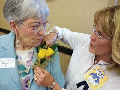 Jane Orr, PHS Class of 1963, pins a corsage on Class of 1938's Yvonne Wilson Morgan on Thursday during a luncheon at the Prescott Resort. (Patrick Whitehurst/The Daily Courier)
