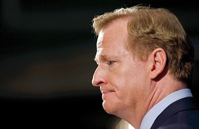 Jason DeCrow/The Associated Press<br>NFL Commissioner Roger Goodell faces more scrutiny during Friday's news conference in New York. Goodell says the NFL wants to implement new personal conduct policies by the Super Bowl. The league has faced increasing criticism that it has not acted quickly or emphatically enough concerning the domestic abuse cases.