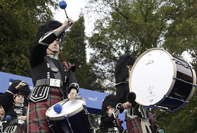 Matt Dunham/The Associated Press<br>A Scottish pipe band perform during the opening ceremony for the Ryder Cup golf tournament at Gleneagles, Scotland, Thursday.