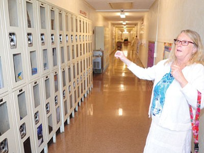Sacred Heart Principal Pamela Dickerson talks about the glass-paneled lockers that are among a number of security measures the school has implemented. (Les Stukenberg /The Daily Courier)