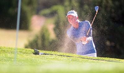 Les Stukenberg/The Daily Courier<br>ERAU's Jennifer Baltimore hits from the trap during the third and final round of the Embry-Riddle Coed Invitational at Talking Rock Ranch Golf Club in Prescott Monday.