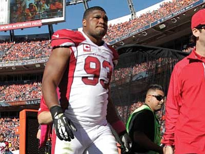 Joe Mahoney, file/The Associated Press<br> Cardinals defensive end Calais Campbell leaves the game against the Denver Broncos during the second half on Sunday. The Cardinals lost seven players to injury in Sunday's loss at Denver.