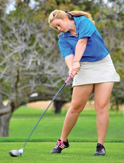 Matt Hinshaw/The Daily Courier<br> Prescott's Aliece Pierce tee's off Tuesday afternoon at Antelope Hills Golf Course while playing against Bradshaw, Mingus, and Coconino High Schools in Prescott. Below, Bradshaw's Tanner Spohn reacts to just missing a putt as part of the tournament.
