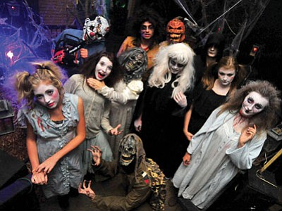 Ghouls, ghosts, creepy dolls and serial killers fill the graveyard at the Scream Factor Haunted Attraction at Frontier Village in Prescott, open Thursday, Friday and Saturday nights till Nov. 1. (Matt Hinshaw/The Daily Courier)