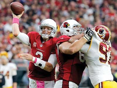 Rick Scuteri/The Associated Press<br> Arizona Cardinals quarterback Carson Palmer throws against the Washington Redskins during the second half of an NFL football game Sunday in Glendale.