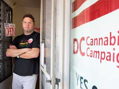 Jacquelyn Martin/The Associated Press<br> Adam Eidinger, chairman of the DC Cannabis Campaign, poses for a portrait at the DC Cannabis Campaign headquarters (his home), where he works in support of DC Ballot Initiative 71.