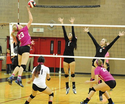 Les Stukenberg/The Daily Courier<br>Prescott's Sydney Koehler (23) goes for a kill on Bradshaw Mountain's Joelle Bobinsky (1) and Katherine Brannan (6) as the Bears hosted their cross-town rival Tuesday night in Prescott Valley.