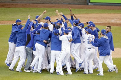Michael Conroy/The Associated Press<br>The Kansas City Royals players celebrate after the Royals defeated the Baltimore Orioles 2-1 in Game 4 of the American League baseball championship series Wednesday, Oct. 15, 2014, in Kansas City, Mo. The Royals advance to the World Series.