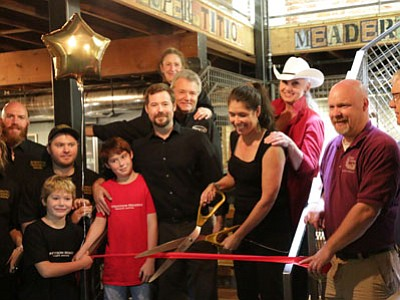 Superstition Meadery opened its new tasting room at the Capital Market, 120 W. Gurley St., with a grand opening and ribbon-cutting Saturday, Oct. 11.  Owners Jeff and Jennifer Herbert are shown cutting the ribbon. (Courtesy photo)