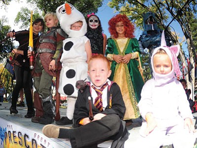 Finalists in the 8-and-under costume contest pose for a photo during the third annual Great Prescott Pumpkin Patch event in downtown Prescott Saturday. (Les Stukenberg/The Daily Courier)