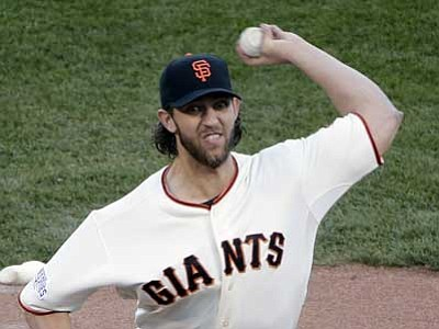 Marcio Jose Sanchez/The Associated Press<br> San Francisco Giants' Madison Bumgarner delivers a pitch during Game 5 of baseball's World Series against the Kansas City Royals on Sunday in San Francisco.