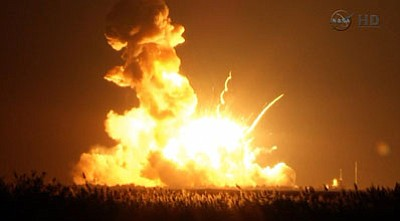 This image taken from video provided by NASA TV shows Orbital Sciences Corp.'s unmanned rocket blowing up over the launch complex at Wallops Island, Virginia, just six seconds after liftoff. The company says no one was believed to be hurt and the damage appeared to be limited to the facilities. (AP Photo/NASA TV)