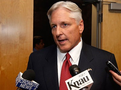 In this Monday, Sept. 29, 2014, file photo, Fred DuVal, Democrat candidate for Arizona governor, speaks to reporters after a televised debate in Phoenix. (Associated Press photo/Ross D. Franklin, file)