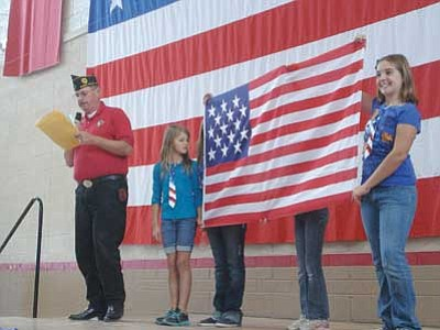 Courtesy photo<br> Students at Del Rio Elementary display a flag from troops in Afghanistan.