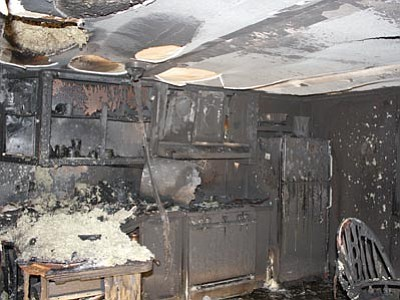Chino Valley Police/Courtesy photo<br>The inside of a mobile home in Chino Valley shows the aftermath of Sunday's fire.
