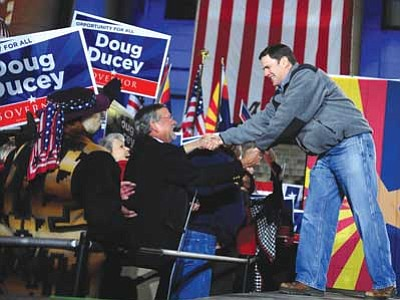 Les Stukenberg/The Daily Courier<br>Arizona Republican gubernatorial candidate Doug Ducey greets supporters, including Yavapai County Supervisor Rowle Simmons, during the Republican Party Victory Rally on the Yavapai County Courthouse Plaza Monday night.