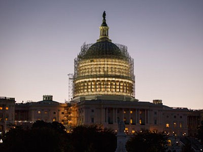 In this Oct, 24, 2014, file photo, the Capitol Dome is nearly obscured by scaffolding at dawn in Washington as restoration efforts continue. Riding a powerful wave of voter discontent, resurgent Republicans captured control of the Senate and tightened their grip on the House on Tuesday night. (Associated Press, file photo)