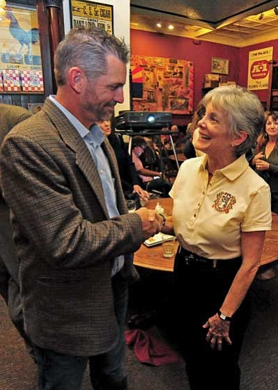 Prescott Unified School District board candidates Maureen Erickson (incumbent) and Greg Mengarelli congratulate each other after being elected and re-elected to the board Tuesday night at the Palace Saloon in downtown Prescott. (Matt Hinshaw/The Daily Courier)